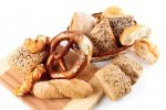 9621621-various-assortment-of-whole-grain-bread-on-a-wooden-board-and-basket